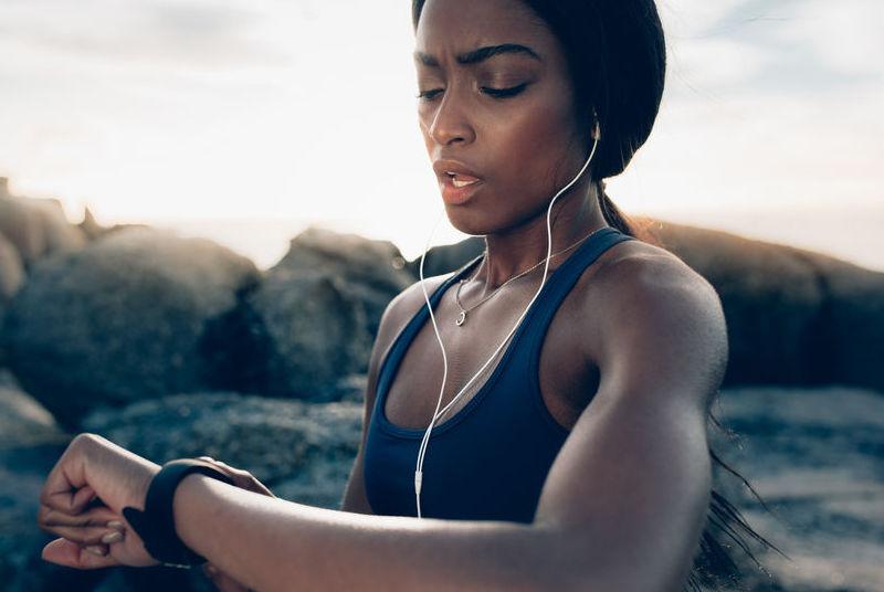 Runner checking fitness progress on her smartwatch